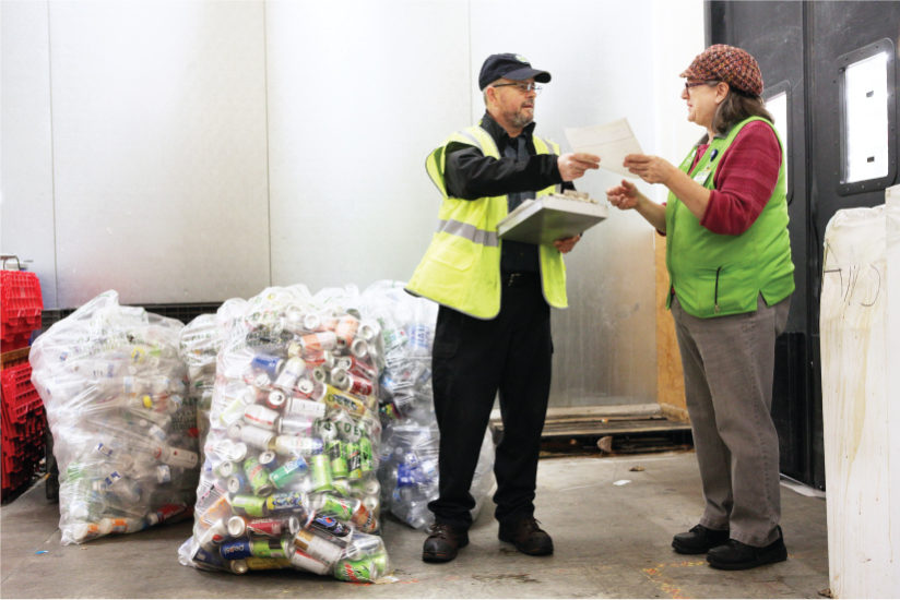 Staff Receiving Bags of Container