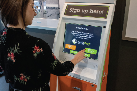 Person signing up for BottleDrop account at a BottleDrop kiosk
