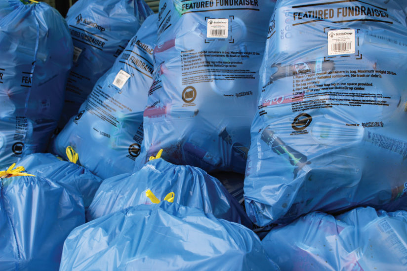 Close up image of a larges stack of Blue Bags from a BottleDrop Give fundraiser's event of the nonprofit's supporters dropping off bags.